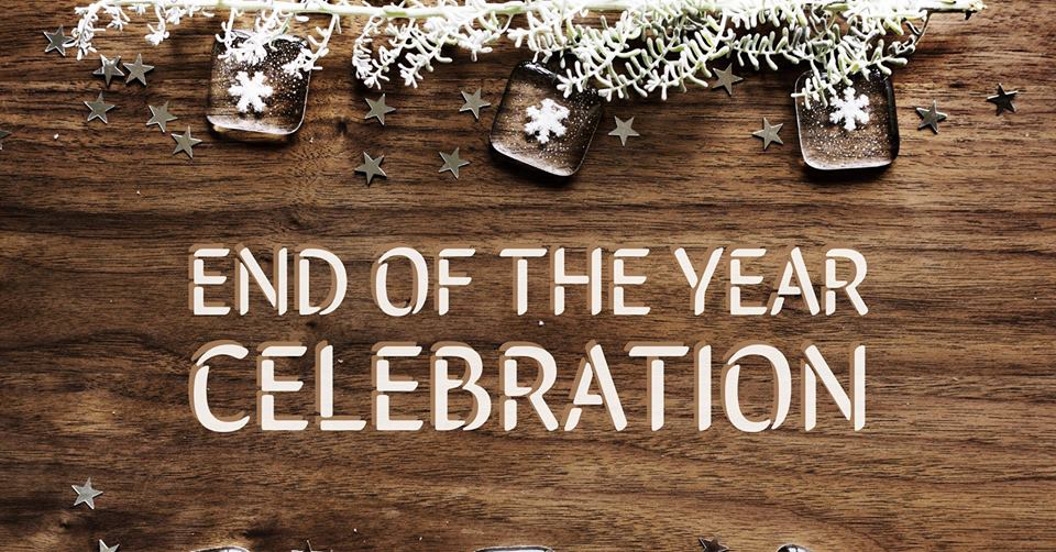 "Image description: a wooden backdrop withal silver metallic stars and frosted evergreen branches and snowflakes. And overlaid text reads, ""End Of The Year Celebration""."