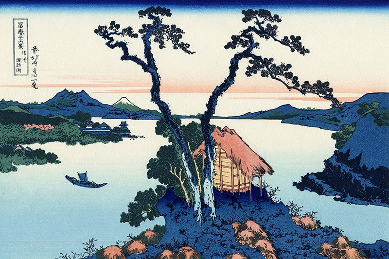 Image description: A woodblock print of Hokusai's 36 Views of Mt. Fuji showing a lake with a small outcropping with a hut and 3 trees.