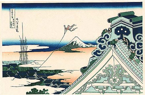 Image Description: A print of one of Hokusai's 36 Views of Mt. Fuji, depicting a temple roof top in the foreground with a kite flying and Mt. Fuji in the background.