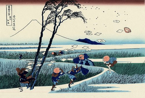 Image Description: A print of one of Hokusai's 36 Views of Mt. Fuji depicting people walking a path in a marsh land with Mt. Fuji in the background. They are dressed in typical Japanese garb which is blowing in the wind, along with one person's papers.