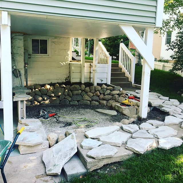 Base, rock wall, and steps in yesterday. Now time for flagstone! #landscaping #hardscaping #hardscape #landscape #flagstone #patio #fondulac #frankfortmichigan