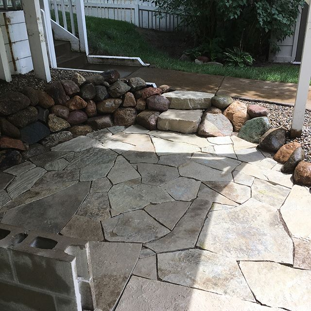 BAM! All wrapped up with this patio and rock wall. #landscape #landscaping #hardscape #hardscaping #flagstone #flagstonepatio #rockwall #keepcraftalive #frankfortmichigan
