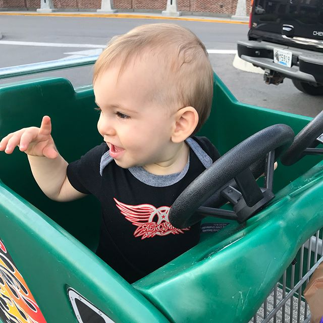 Lil man wasn't feeling good... wish I'd known earlier that all it was going to take was a cool shopping cart to make it better!!