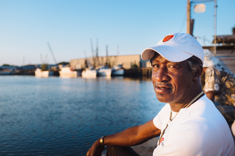 "Anyone that spent time living in Linconville has know Ford ""Pretty Gitty."" I usually catch him down at the dock throwing out a line for redfish. He'll hang out and lend a hand as boats unload- taking home a little bucket of shrimp"