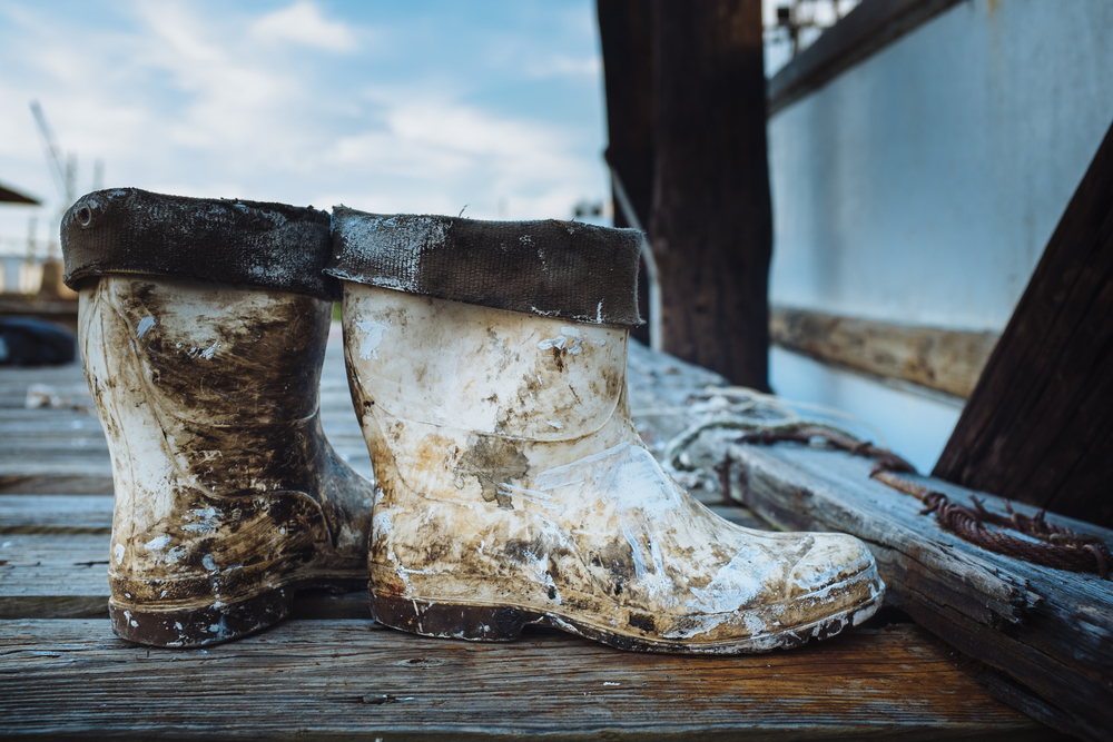 The white boots are iconic footwear of the shrimping lifestyle. I once ran into a sunburnt tattooed shrimper at tradewinds lounge still wearing his white boots, when I asked him if he was a shrimper he reached in and pulled out a small blade covered in fish parts.
