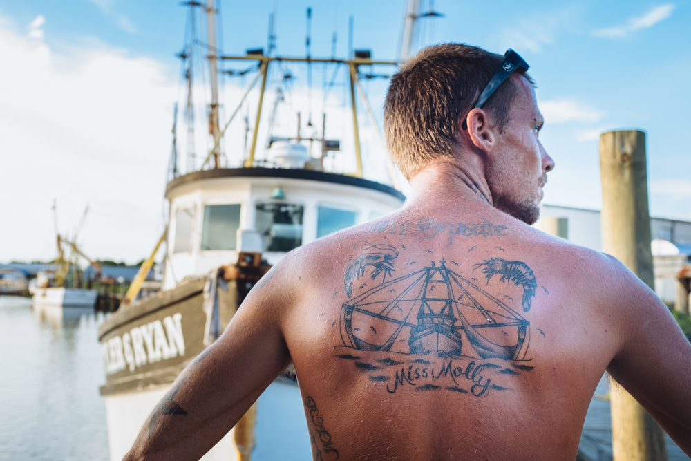 Timmy proudly shows off his trawler back piece.