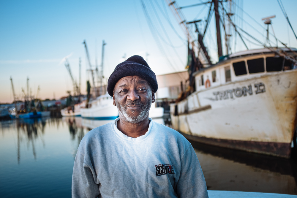 "Supposedly Captain Billy and Raymond go way back. Raymond told me he helped Billy out of a jam once, and now he gets pick of the best seafood every time his boat comes in. Here he is, ""collecting,"" as he put it."