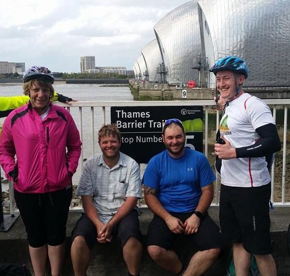 (L-R) Cass Simpson, Mark Richards, Al Stuart and Paul Fox. At the Thames Barrier and all very tired after four days cycling!