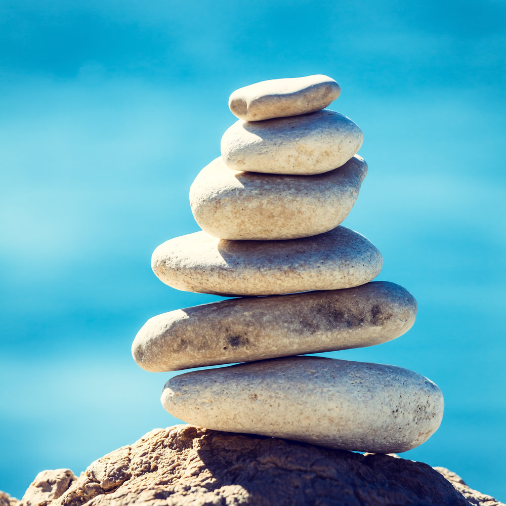stones-balance-vintage-pebbles-stack-background-PEHQU5W.jpg