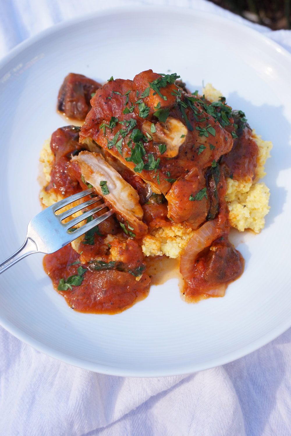Comforting   Tomato Braised Chicken   and Mushrooms over Polenta   Recipe