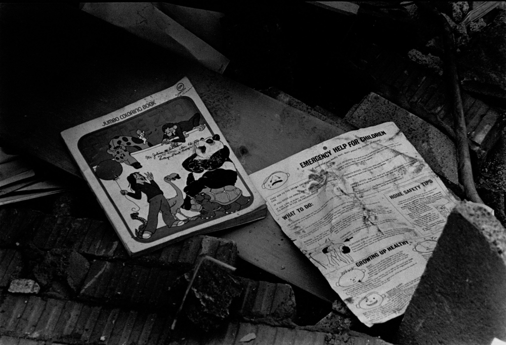 School books and debris from the Bowen Homes Explosion. Photograph by Jerome McClendon (1980) Atlanta Journal-Constitution Photographic Archives. Special Collections and Archives, Georgia State University Library.