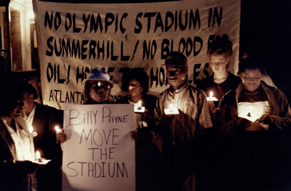 Protestors outside Olympics Chief Billy Payne's House.  File photograph from the   Atlanta Journal-Constitution Photographic Archives. Special Collections and Archives, Georgia State University Library.