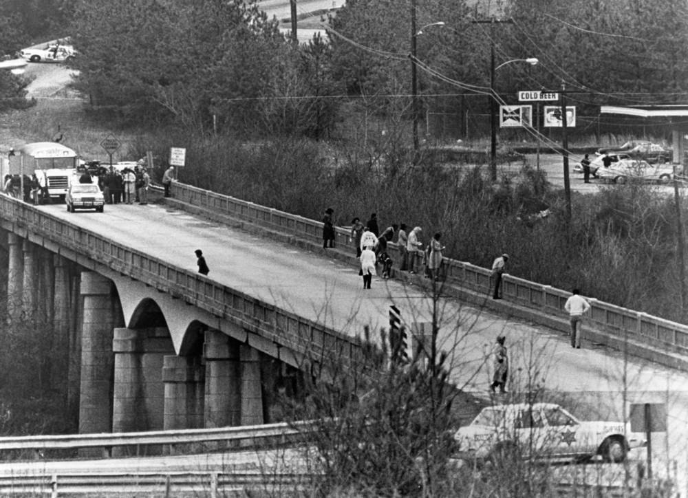 Jurors on the Wayne Williams trial see the bridge location of the suspected body dumping site. Photograph by Dwight Ross (1982) Atlanta Journal-Constitution Photographic Archives. Special Collections and Archives, Georgia State University Library.