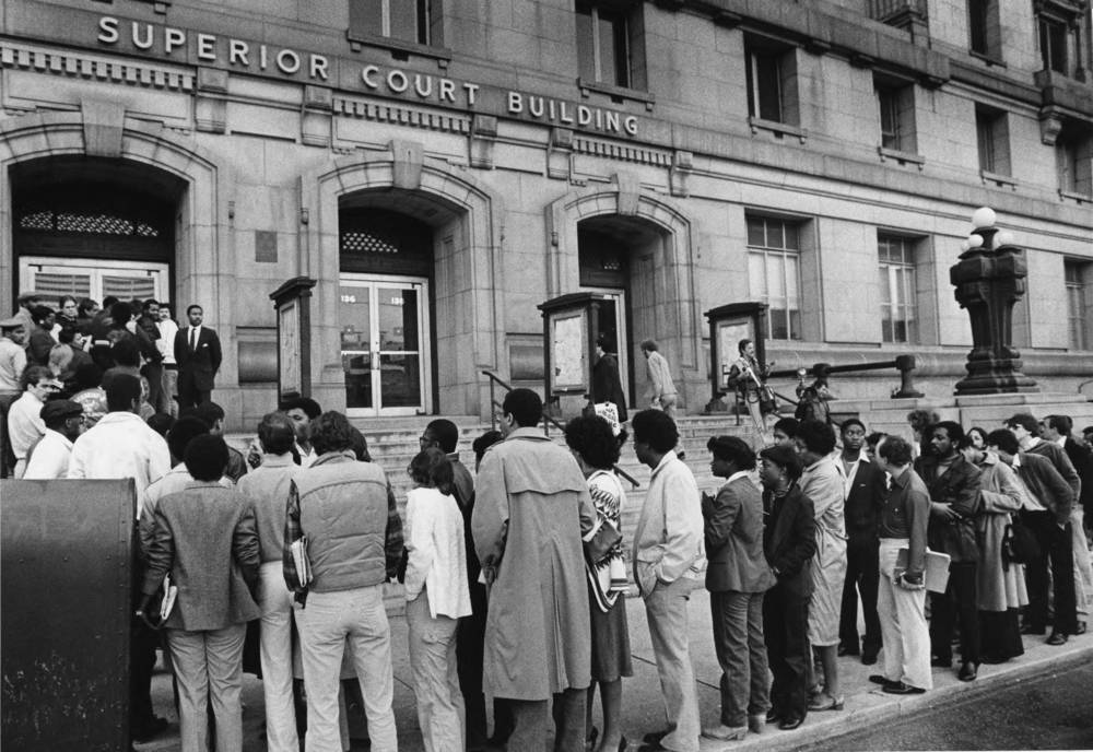 Crowds of people waiting to see Wayne Williams trial.  Photograph by W. A. Bridges (1982  ) Atlanta Journal-Constitution Photographic Archives. Special Collections and Archives, Georgia State University Library.
