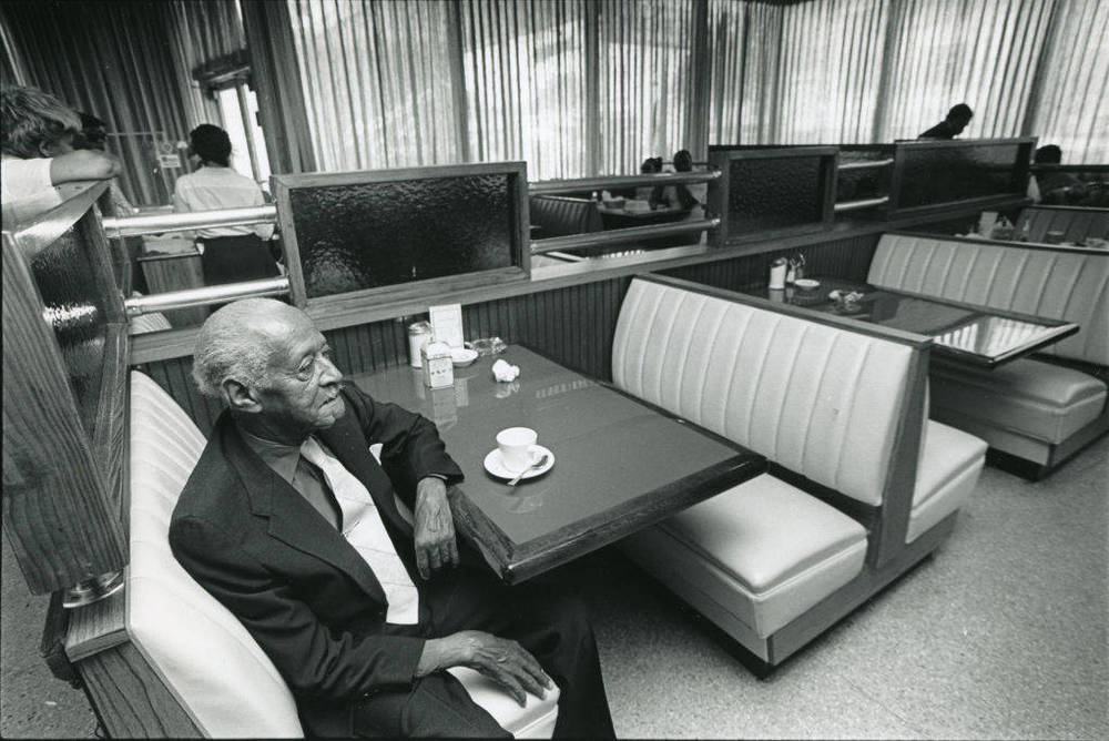 Gilmer Paschal in Paschal's Restaurant.  Photograph by Andy Sharp. Atlanta Journal-Constitution Photographic Archives. Special Collections and Archives, Georgia State University Library.