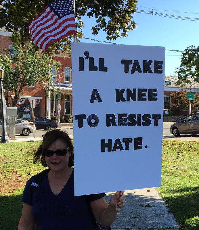 Ann Pompelio knee to resist hate.2.jpg