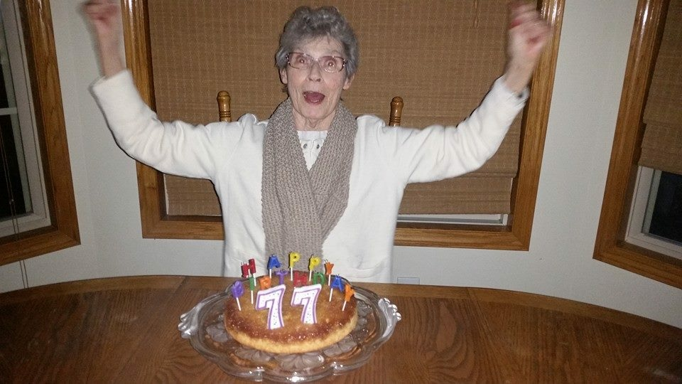 Grandma celebrating her ability to blow out all of her birthday candles