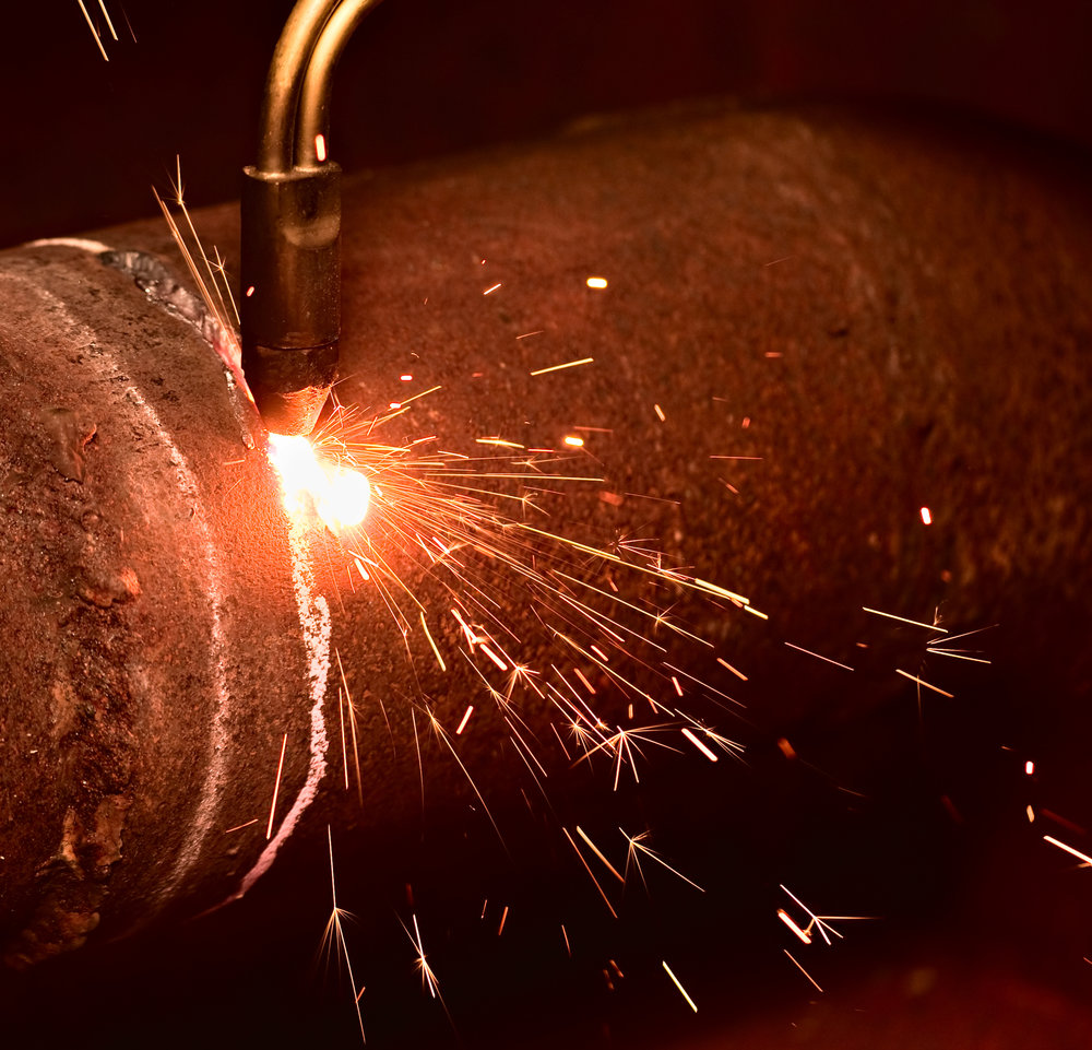 A canister being cut open to reveal high performance blade steel.