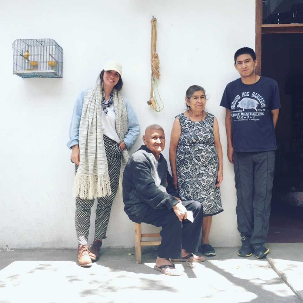 Emiliano, center, Delfina, and their youngest son, Gabino, in the courtyard of their family home in the Oaxaca Valley.