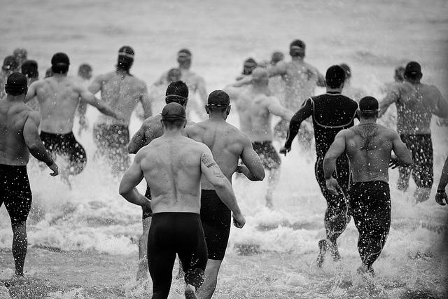 "fuckyeahcrossfit :      Run  by  Eric ""Claptøn"" Nelsøn  on Flickr.     Breakfast: 100 pull ups, 50 dips, upper body round robin  Lunch:  9 110lb snatch 2000m row 15 110lb snatch 1000m row 21 110lb snatch 500m row 26:15  Dinner: swim 300m 8 x 25m changing strokes 4 x 100m @ 100% 8 x 25 w/kick board 100m"