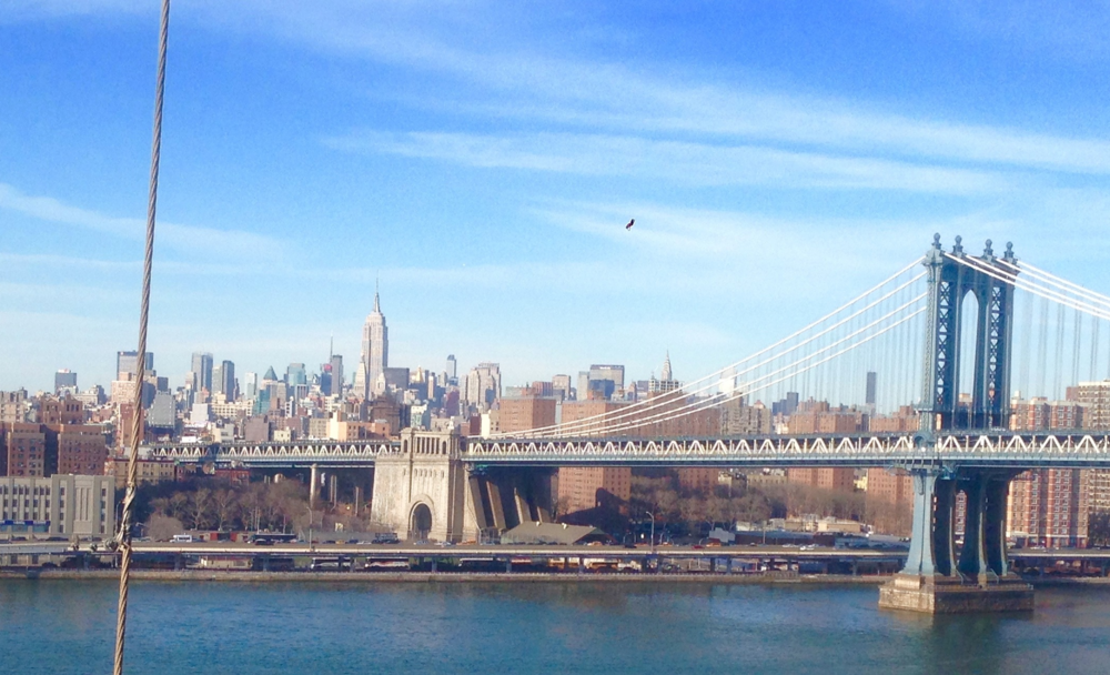 Looking towards Mid-Town Manhattan from the Brooklyn Bridge
