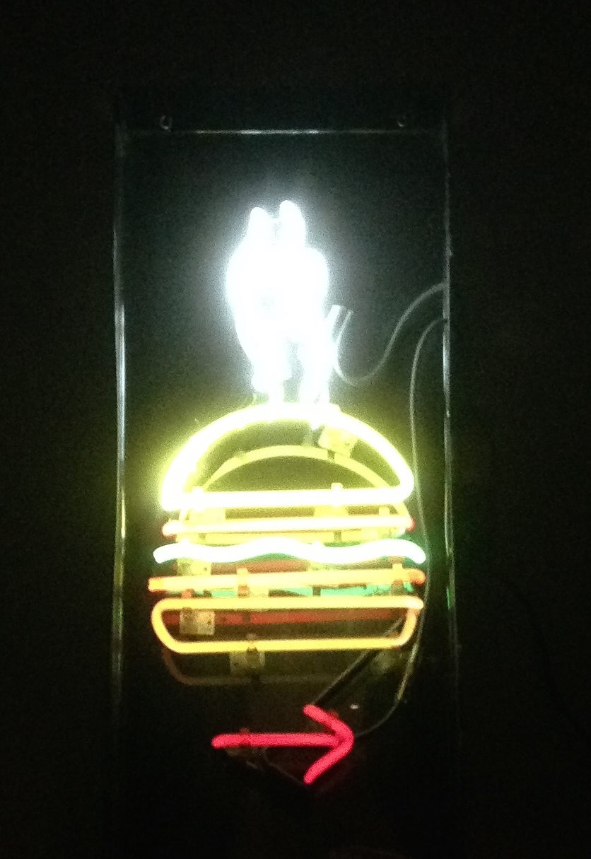 the hidden burger bar's neon sign