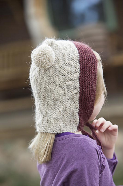 The  Grain Hood . Courtney used one of my all time favorite stitch patterns in this clever, color-blocked bonnet! I love that the length in the back will keep my little one's neck warm!