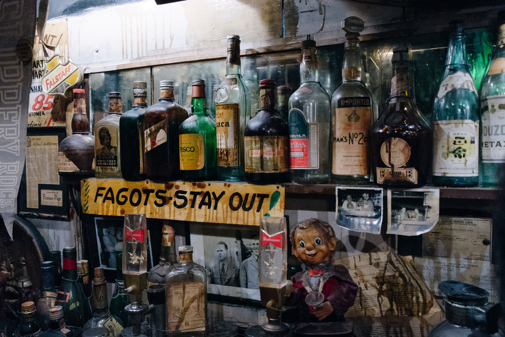 "The misspelled sign ""Faggots stay out"" is a replica of a controversial object that used to be displayed at the original ""Beanery"".  Read more about it ."