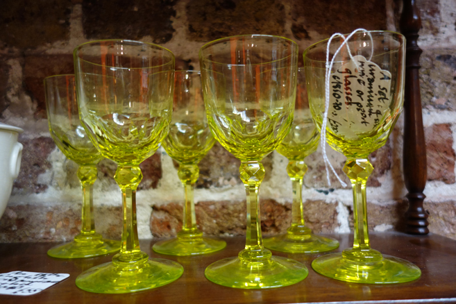 A set of antique yellow glasses