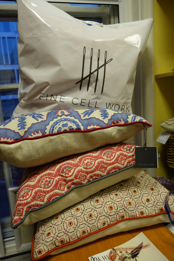 Cushions stacked up at Fine Cell Work
