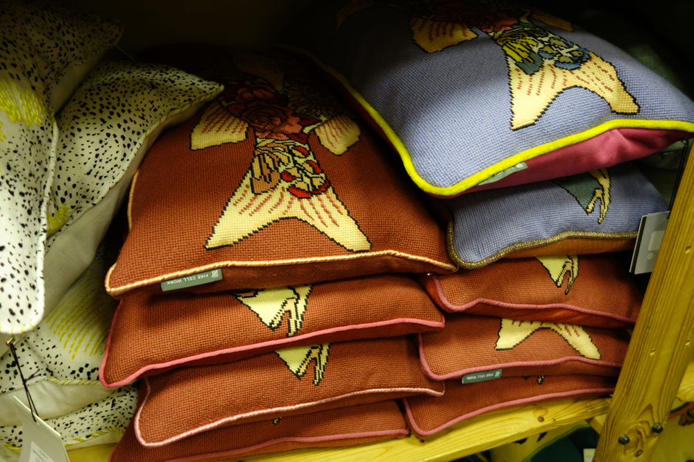 cushions piled high at Fine Cell Work