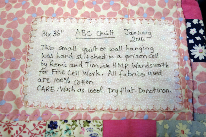 Label from a Fine Cell Work quilt stating the prisoner's name who made it.