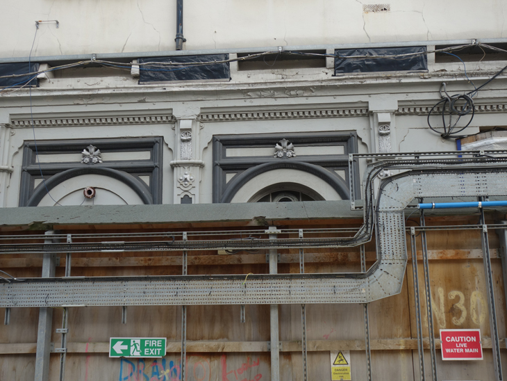 The grey mouldings of the old Grade I listed paddington railway station.