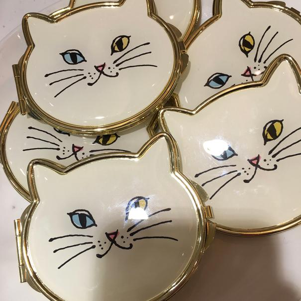 cat handbag mirrors
