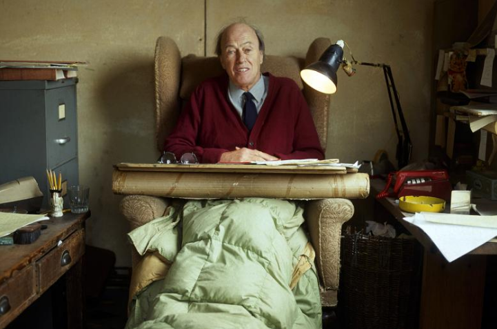 Love this picture of him tucked up under an eiderdown, writing in his shed.