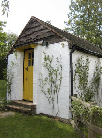 Roald Dahl's writing shed with yellow door