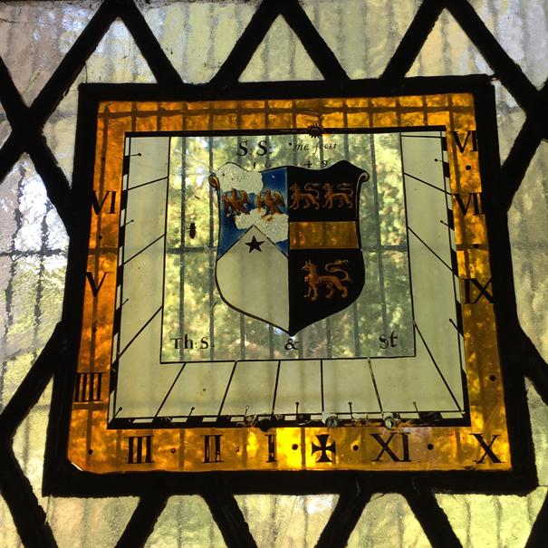 Time flies sun dial at Bucklebury church Berkshire