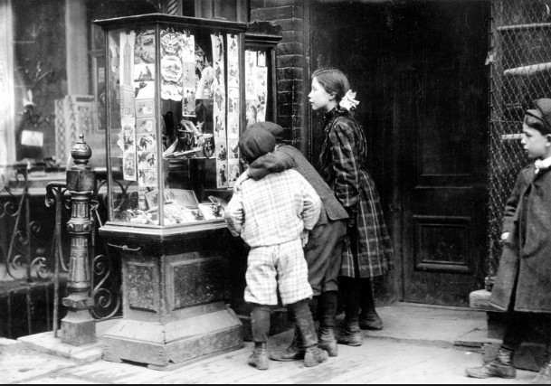 Victorian children choosing Christmas cards