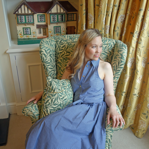 Isla Simpson sitting in her Parker Knoll chair at home