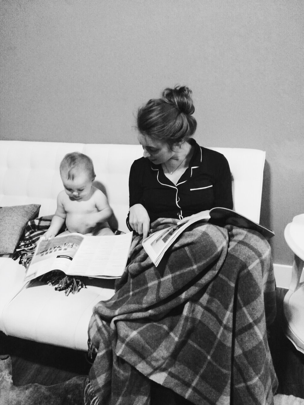 Early 2016, shortly after W turned 1. Reading out books together.