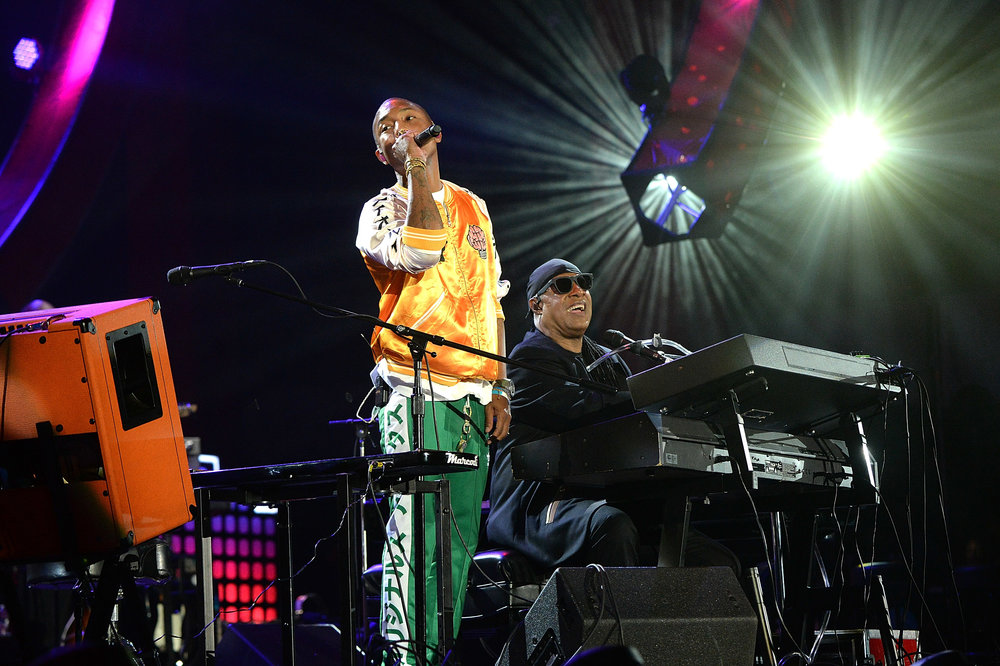 | PHOTOGRAPHY Kevin Mazur/Getty Images for Global Citizen) - Pharrell Williams; Stevie Wonder |