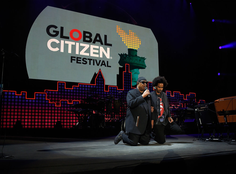 | PHOTOGRAPHY Kevin Mazur/Getty Images for Global Citizen - Stevie Wonder; Kwame Morris |