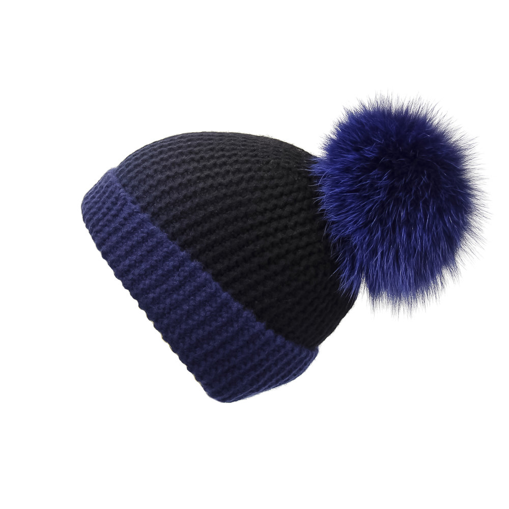 LOVE KNITZ - Adding a pop of fur is cute but this ribbed hat is an essential to keep in the warmth in a chic way.