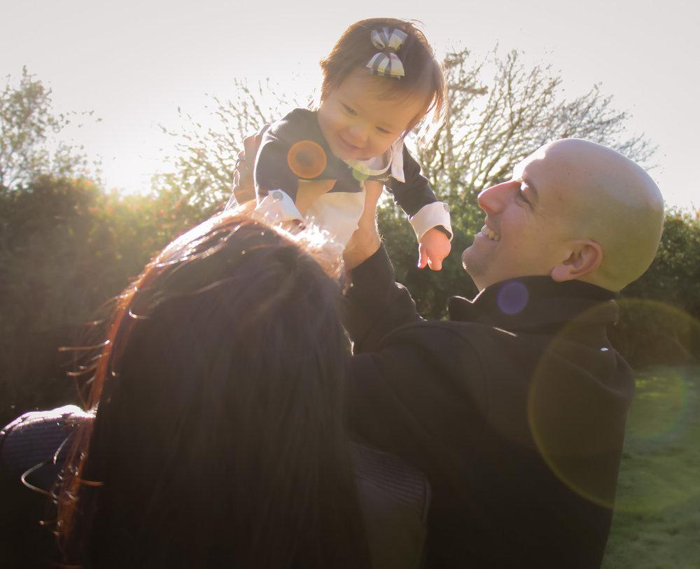 Parents lifting child
