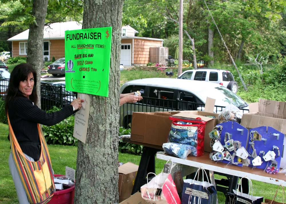 A volunteer from the S.E.M. Foundation helping us raise seed capital through a yard sale at Pequash Beach in New York circa 2011.