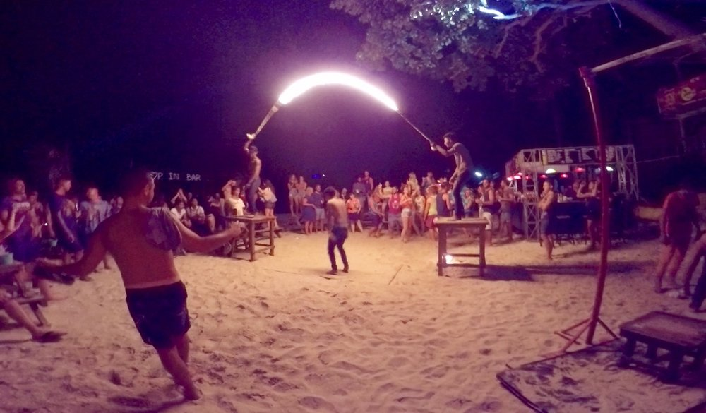 Fire Rope Jumping: One of the many activities on the island at night!