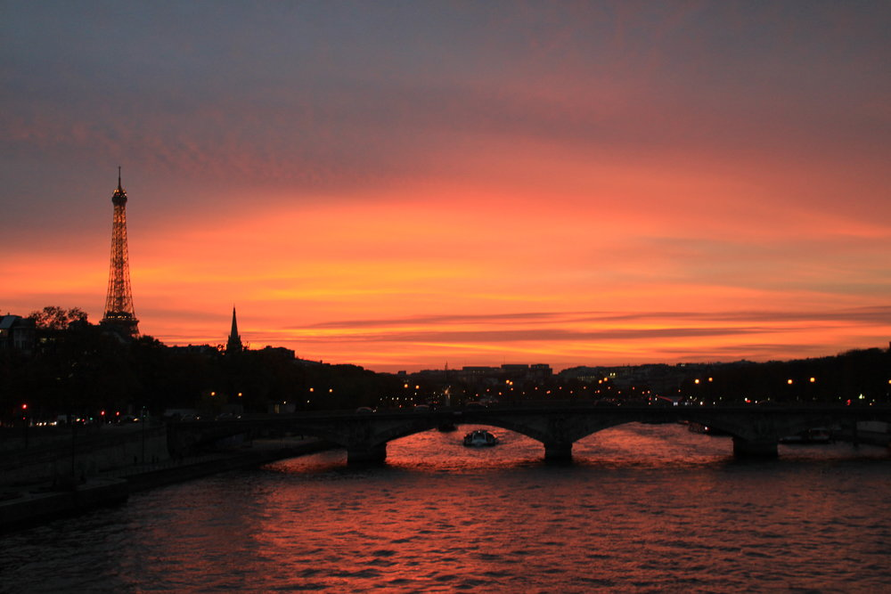 Watching stunning sunsets from the Seine River just cannot be beat. That view!