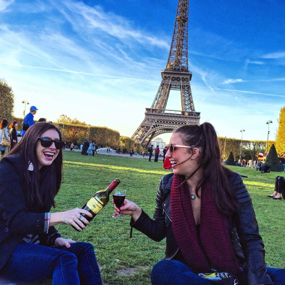 Picnics at the Eiffel Tower. Wine, cheese, and bread....need I say more?