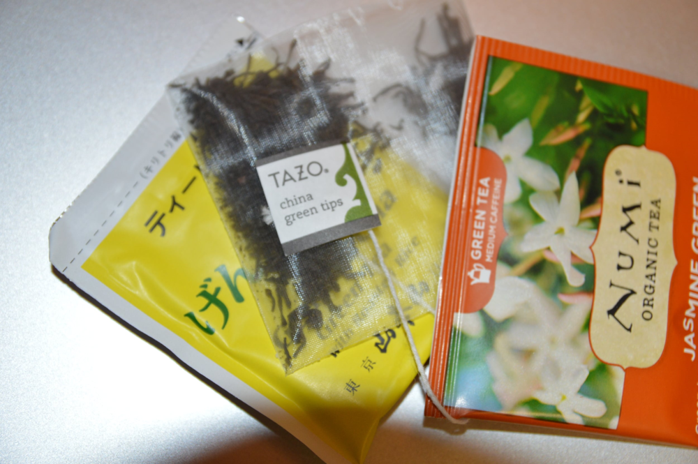 Pictured L-R:   Yamamotoyama ,  Tazo , and  Numi  green tea bags, three of my favorite brands!