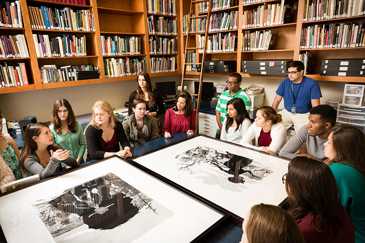 Rollins students discussing Kara Walker's work in the print study room at the Cornell Museum of Fine Arts (photo by Scott Cook).
